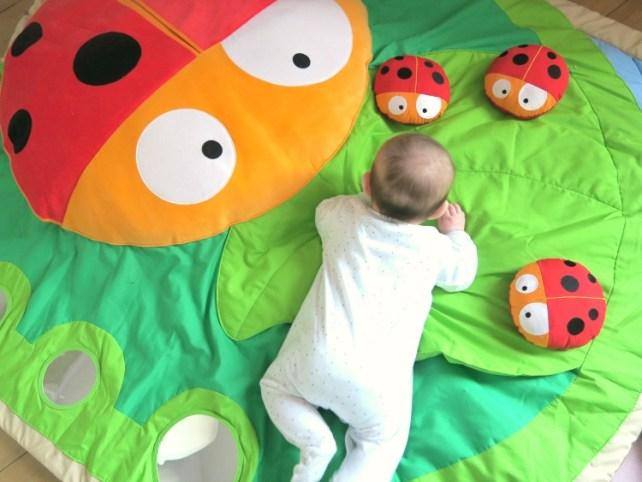 bébé sur tapis éveil coccinelle Wesco family avis