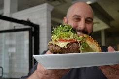 Chef Nick Speros shows off his work of art: a perfectly crafted local burger.