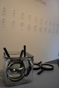 The Loading Dock Gallery provides magnifying glasses for attendees' viewing ease.