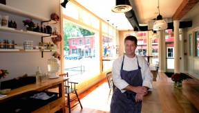 Ben Elliott in the Saltbox Kitchen dining room.