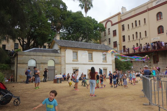 Australia Day at The Rocks - fun for the kids outside Cadmans Cottage - the oldest surviving residential building in Sydney, Australia, having been built in 1816 for the use of the governmental coxswains and their crews.