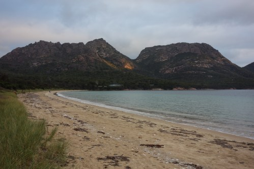 Sunset illuminating a patch on the mountains at Freycinet NP