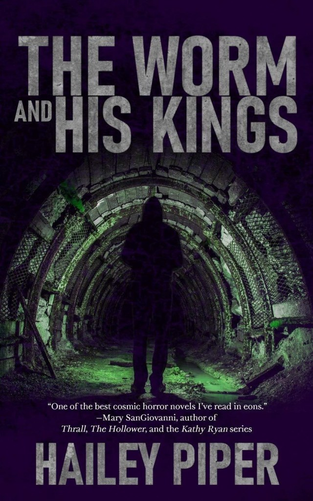 Cover of The Worm and His Kings by Hailey Piper. Shows the silhouette of a woman standing in dark a sewer tunnel, the floor of which is covered with lime green glowing waste.