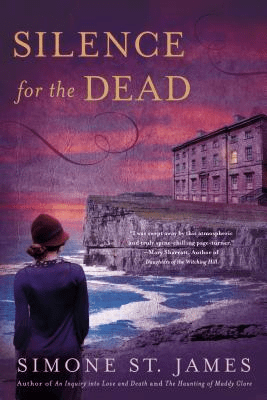 Cover of Silence for the Dead by Simone St James. Cover shows a woman standing on a beach, looking out at a building that must be a hospital or some other kind of institution. The building is on the top of a cliff above the water. The sun is setting in the background.