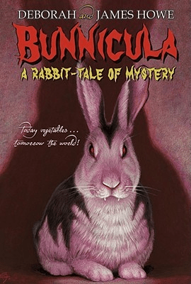 Cover of Bunnicula by Deborah and James Howe. Cover shows an illustration of a black and white bunny with red glowing eyes and vampire fangs. The bunny casts a menacing, large shadow on the wall behind it.