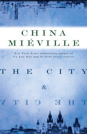 Cover of The City & The City by China Miéville. Cover shows two cities: one at the bottom of the cover, with an older almost Eastern European architecture, and one at the top of the cover and upside down, with a modern skyscraper architecture.