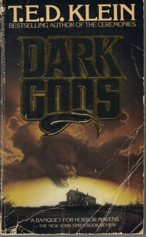 Cover of Dark Gods by T.E.D. Klein. Cover shows a house in a stark landscape. Storm clouds gather in the sky. A creature appears to be lunging for the house from the clouds, jaws open.