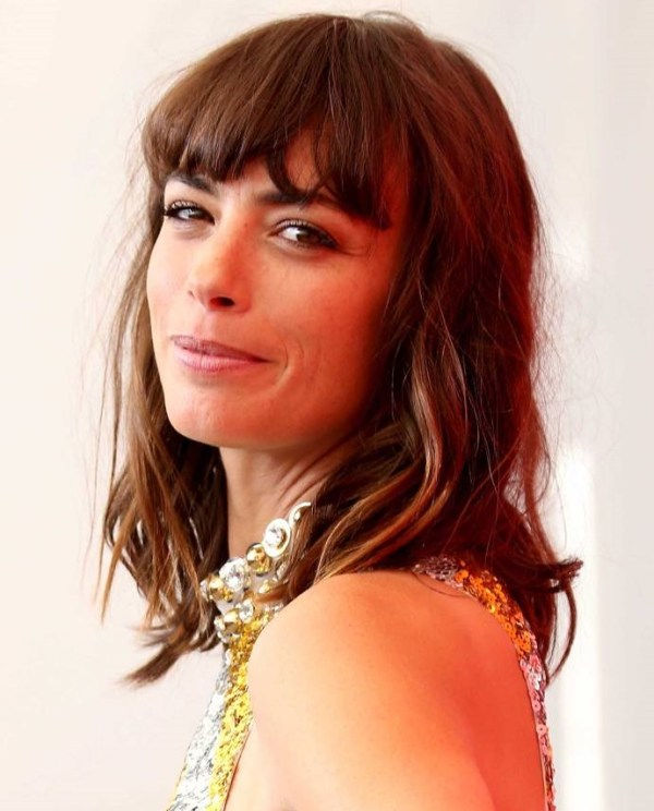 Thinned haircut for medium lenght hair with bangs