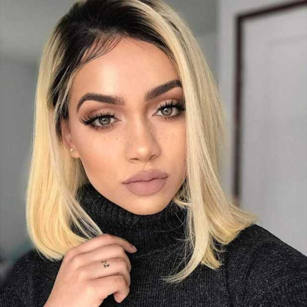 Blonde medium length hair dark roots