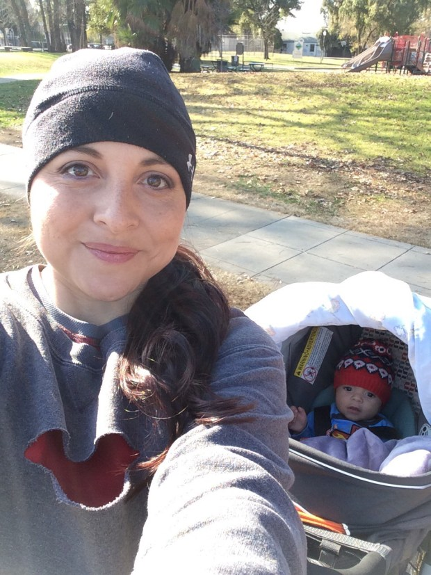healthy lifestyle woman running with baby in a stroller