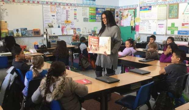 school board trustee reading to students