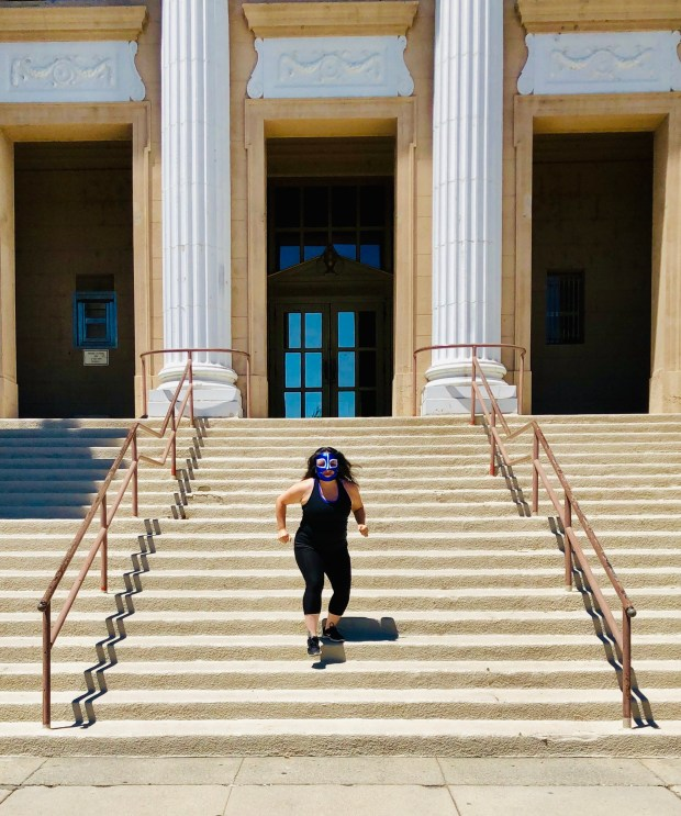 Woman running down steps of City Hall
