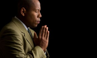 black man praying