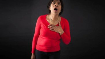woman suffering from heart attack