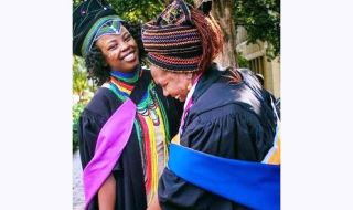 mother and daughter in graduation gown