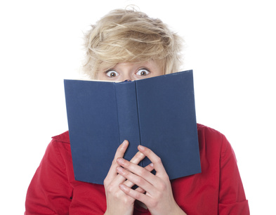 Surprised woman reading a romance novel