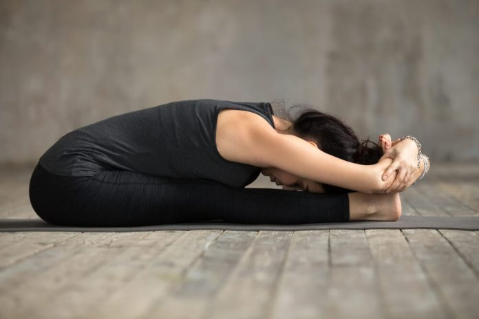 Sit and Forward Bend Pose for Headaches