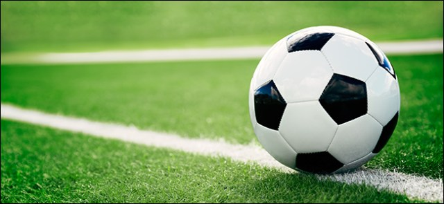 Traditional soccer ball on the football field