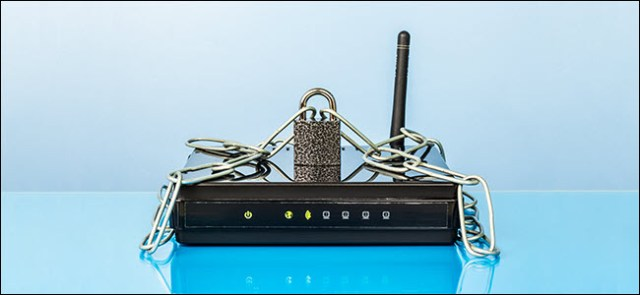 Router, chain and padlock. Wi-Fi network protected by password