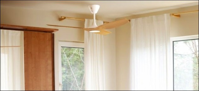 A Haiku Smart fan hanging from a ceiling