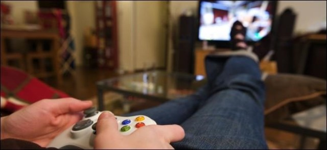 An image of a person with feet playing a video game.
