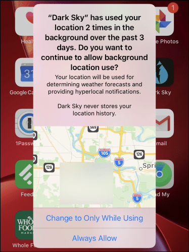 A background location usage warning for Dark Sky on the iPhone home screen.