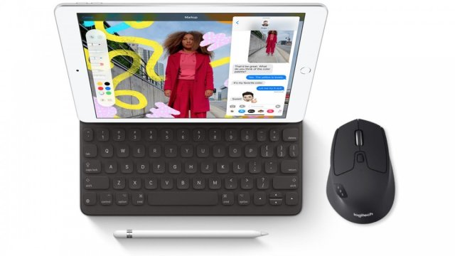 The iPad with a Logitech Triathalon keyboard, pencil and mouse