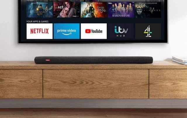 The sound bar sat on a sideboard under a TV