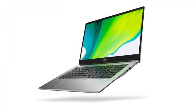 An Acer Swift 4 laptop with a swirling green desktop background.