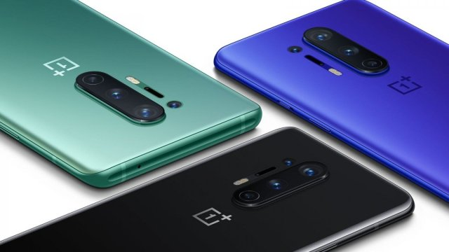 Three OnePlus 8 phones in green, blue and black.