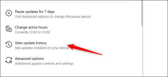 A red arrow pointing to the Update history option in the Settings application