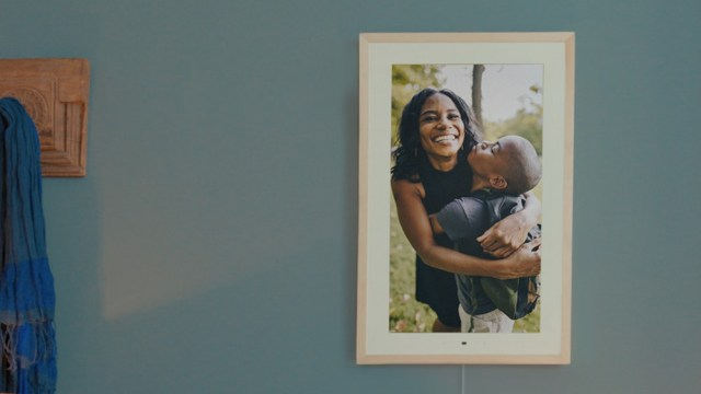 The Lenovo Smart Frame with a hugging mother and son.
