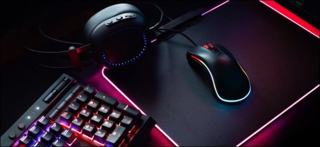 A gaming keyboard, a mouse and headphones.