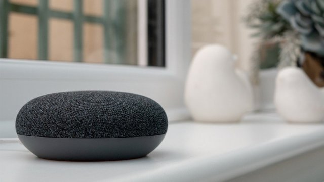 A photo of a Google Nest Mini on a counter.