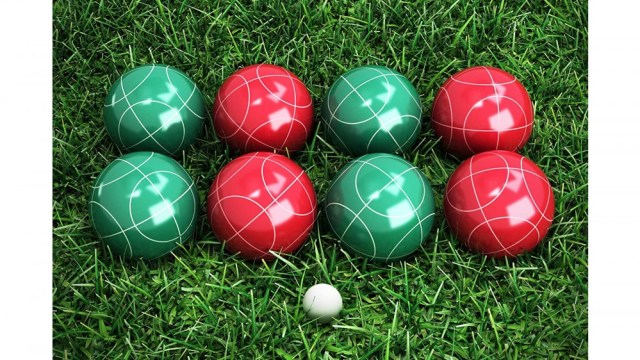 set of petanque balls and market ball on grass
