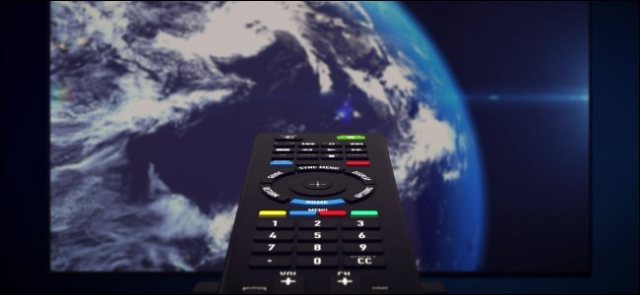 An infrared remote control pointed at a television screen showing the planet Earth.