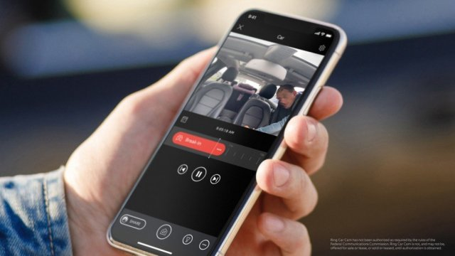 Camera footage on a phone looking inside a car.