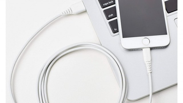 An AmazonBasics lighting cable, connecting an iPhone to a Mac