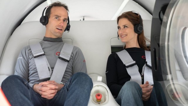 Company Co-Founder Josh Giegel and Head of Passenger Experience Sara Luchian, seated in the Virgin Hyperloop Pod