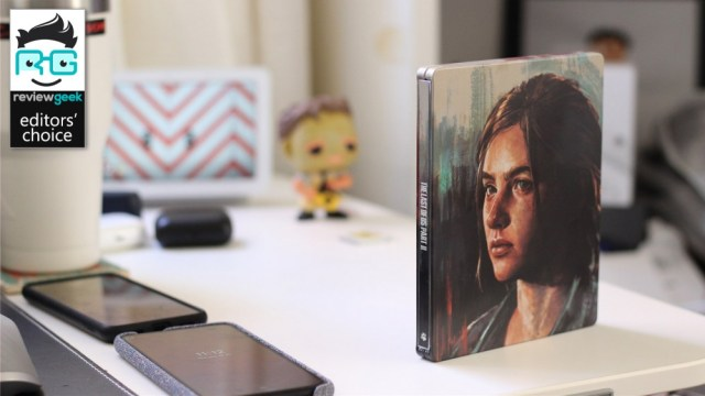 Limited edition Last of Us Part II case on white desk with Nest Hub and Funko Pop in the background