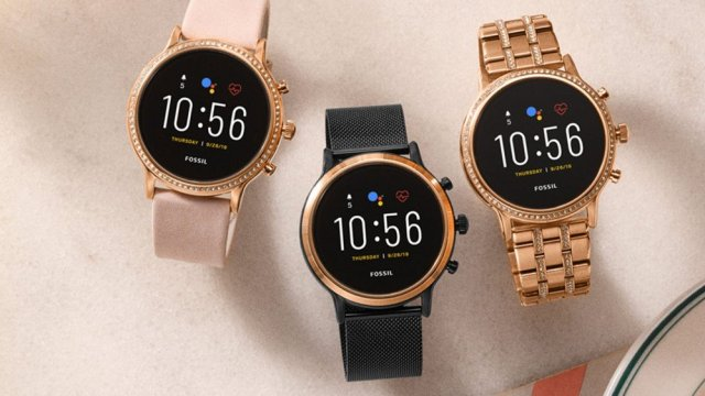 Three Fossil Gen 5 smartwatches in different colors.