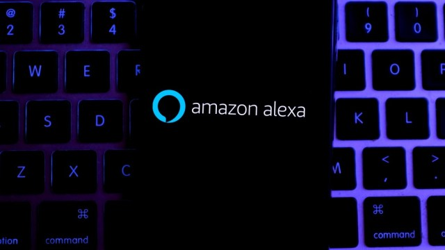 Amazon Alexa on an iPhone using a MacBook keyboard.