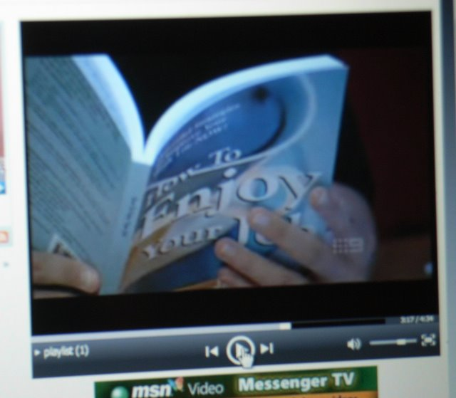 Reading book on TV