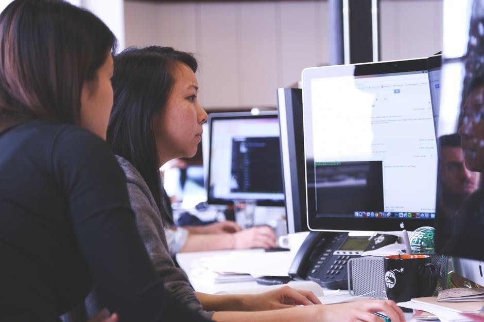two women working on their software as a service company
