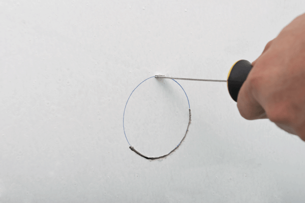 Cutting a circular hole in drywall