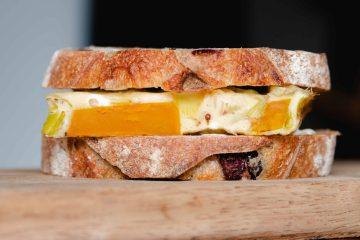 baked omelette sandwich on rustic olive bread