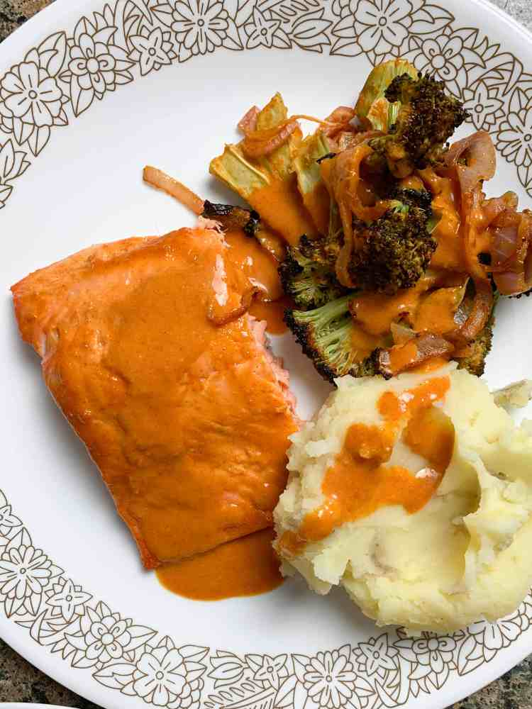 roasted broccoli, salmon, and mashed potatoes on a plate