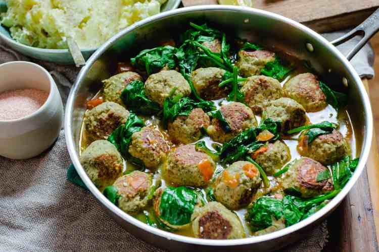 brothy meatballs with spinach.