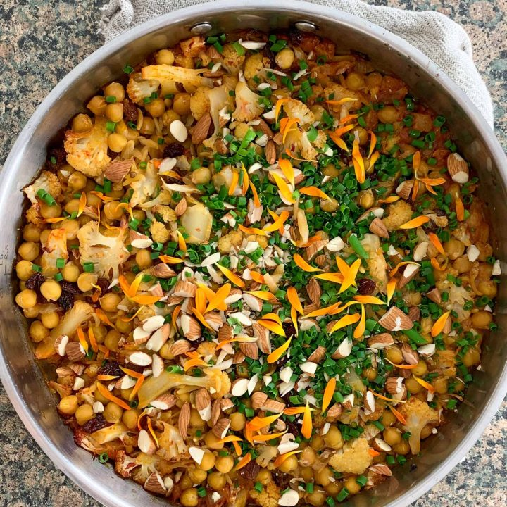 a pan of baked orzo with herbs on top.