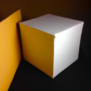 White Cube with Yellow Reflected Light. Your mind tries to tell you the cube is white but there are at least three colors here: yellow, white, and gray